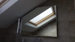 Shaped mirror with steam demister and side light for attic bathroom in Leopardstown Co Dublin BA 0504m